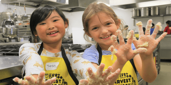Charity: OzHarvest, giving school students food